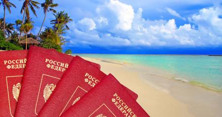 International passports of Russia against a tropical beach